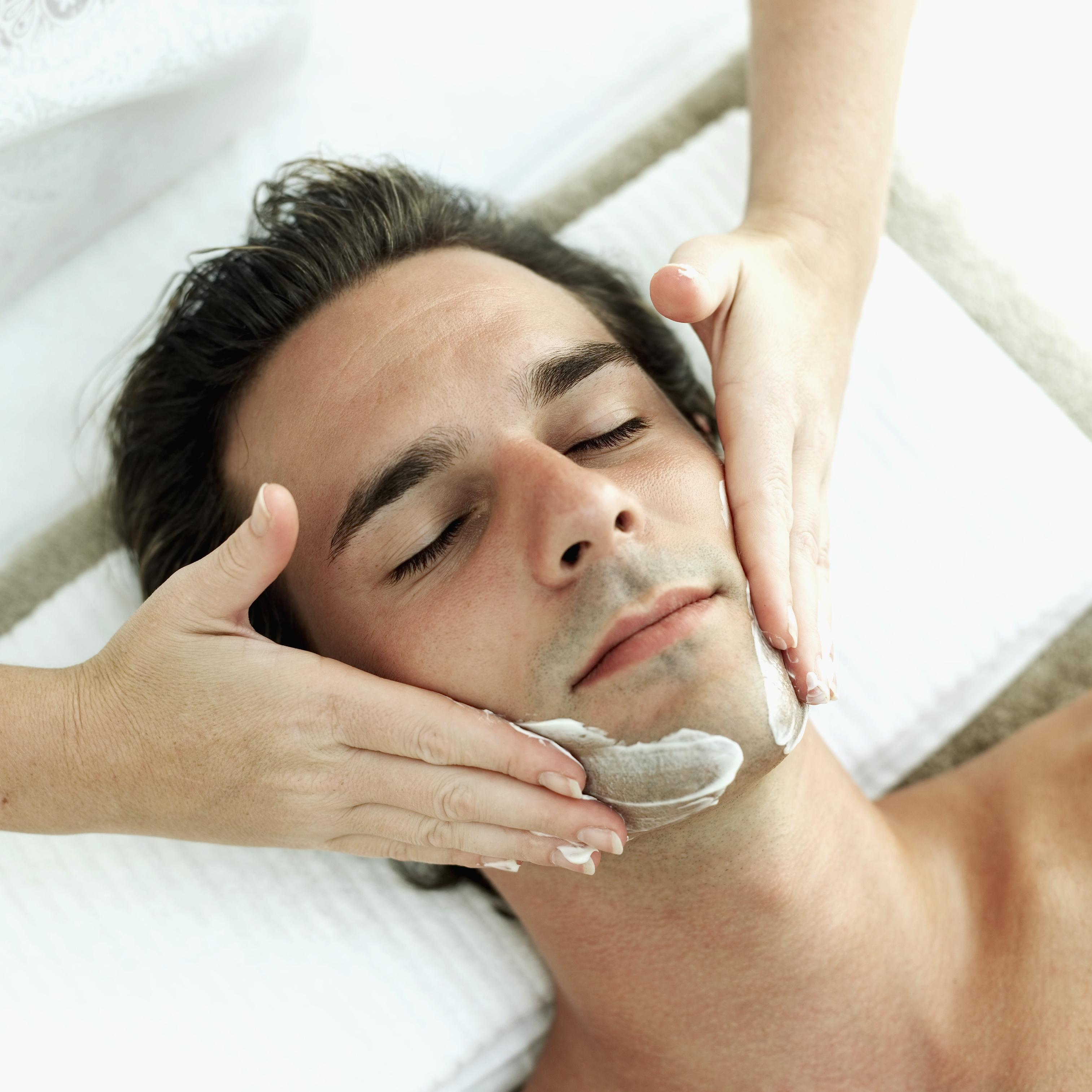 Elevated view of a young man getting a facial